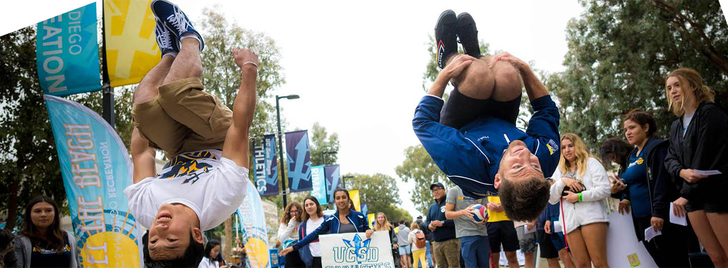 Two UC San Diego students do flips in the air