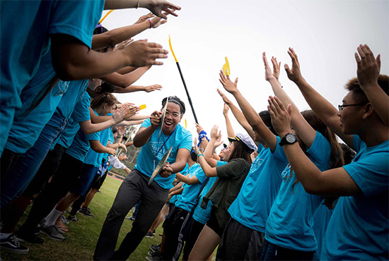 UC San Diego students participating in annual Welcome Week activities - it's a high-five gauntlet